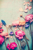 Pretty flowers retro pastel toned on vintage turquoise background. Top view royalty free stock photos