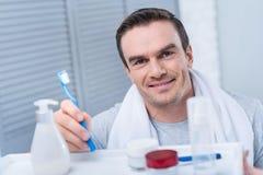 Pretty focused man shaving in the morning Stock Photo