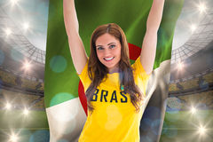 Pretty football fan in brasil t-shirt holding algeria flag Royalty Free Stock Images