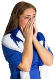 Pretty football fan looking nervous Royalty Free Stock Photography