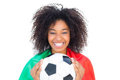 Pretty football fan with portugal flag holding ball Stock Photo