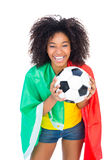 Pretty football fan with portugal flag holding ball Stock Photography
