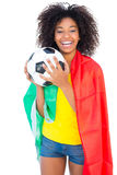 Pretty football fan with portugal flag holding ball Royalty Free Stock Image