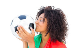 Pretty football fan with portugal flag kissing ball Stock Photography