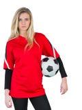 Pretty football fan in red Stock Photo
