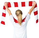 Pretty football fan in white cheering Stock Photos