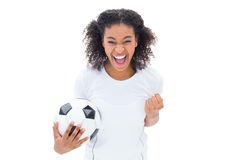Pretty football fan in white cheering at camera Stock Photo