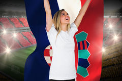 Pretty football fan in white cheering holding croatia flag Stock Image