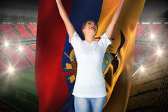 Pretty football fan in white cheering holding ecuador flag Royalty Free Stock Image