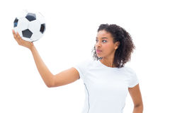 Pretty football fan in white holding ball Stock Photography