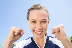 Pretty football player smiling at camera Royalty Free Stock Photography
