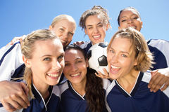 Pretty football players celebrating their win Stock Image