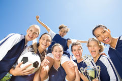 Pretty football players smiling at camera Stock Photography