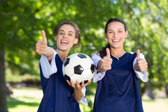 Pretty football players smiling at camera Royalty Free Stock Photo