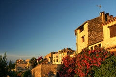 Pretty French village with bright bougainvillea. Pretty French village St Paul de Vence bathed in morning sunlight Stock Image