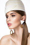 Pretty fresh girl, image of modern Twiggy in fashionable white hat, with unusual eyelashes and accessories. Stock Photo