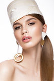 Pretty fresh girl, image of modern Twiggy in fashionable white hat, with unusual eyelashes and accessories. Royalty Free Stock Photography