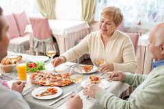 Pretty friendly family is dining in restaurant Royalty Free Stock Images