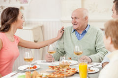 Pretty friendly family has a dinner together Royalty Free Stock Images