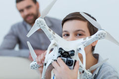 Pretty friendly family is playing with a drone Royalty Free Stock Photo