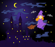 Pretty friendly witch flying on a broomstick in the night sky. O Royalty Free Stock Image