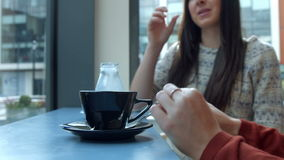 Pretty friends chatting over coffee in cafe. In high quality format stock footage
