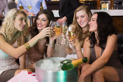 Pretty friends drinking champagne together Royalty Free Stock Images