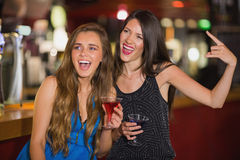 Pretty friends drinking cocktails together. At the nightclub Stock Images