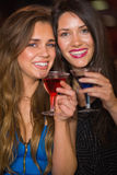 Pretty friends drinking cocktails together. At the nightclub Stock Photography