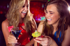 Pretty friends drinking cocktails together Stock Photography