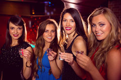Pretty friends drinking shots together Royalty Free Stock Image