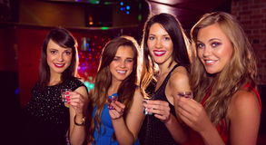 Pretty friends drinking shots together Royalty Free Stock Photos