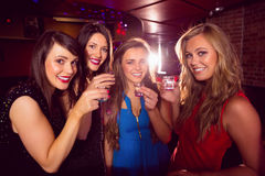 Pretty friends drinking shots together Royalty Free Stock Images