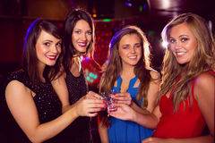 Pretty friends drinking shots together Stock Image