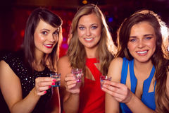 Pretty friends drinking shots together Stock Images