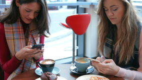 Pretty friends enjoying coffee in cafe. In high quality format stock footage