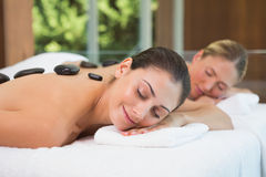 Pretty friends getting hot stone massages together Royalty Free Stock Photo