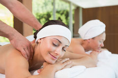 Pretty friends getting massages together Royalty Free Stock Image