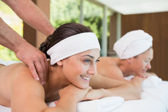 Pretty friends getting massages together Royalty Free Stock Photography