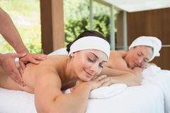 Pretty friends getting massages together Royalty Free Stock Photos