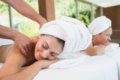 Pretty friends getting massages together Royalty Free Stock Images