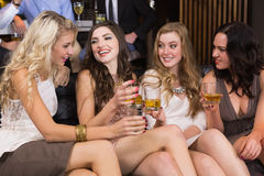 Pretty friends having a drink together Stock Image