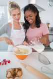 Pretty friends making pastry together Royalty Free Stock Photos