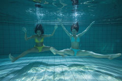 Pretty friends smiling and posing for camera underwater Royalty Free Stock Photography