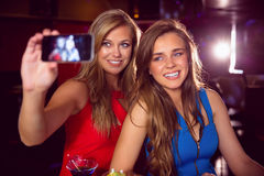 Pretty friends taking a selfie Royalty Free Stock Photos