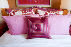 Pretty fun pink bedroom cushions Stock Images
