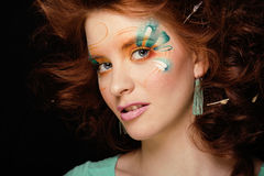 Pretty funny girl with art make up, closeup floral print on face Stock Image