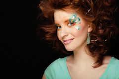 Pretty funny girl with art make up, closeup floral print on face Royalty Free Stock Photos