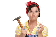 Pretty funny girl  struggling with some housework Royalty Free Stock Photos