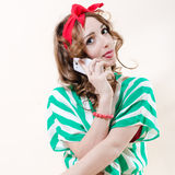 Pretty funny pinup woman & mobile cell phone Stock Photography
